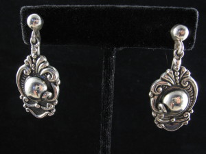 Melicio Rodriguez earring from Margot stamps